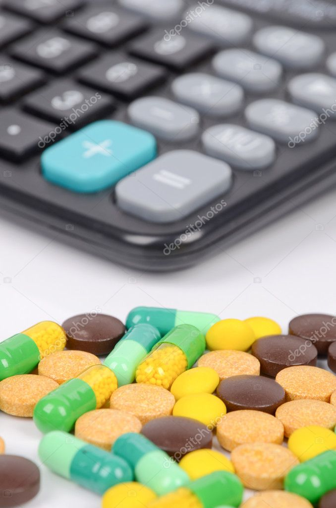 Medicine and calculator — Stock Photo #12388741