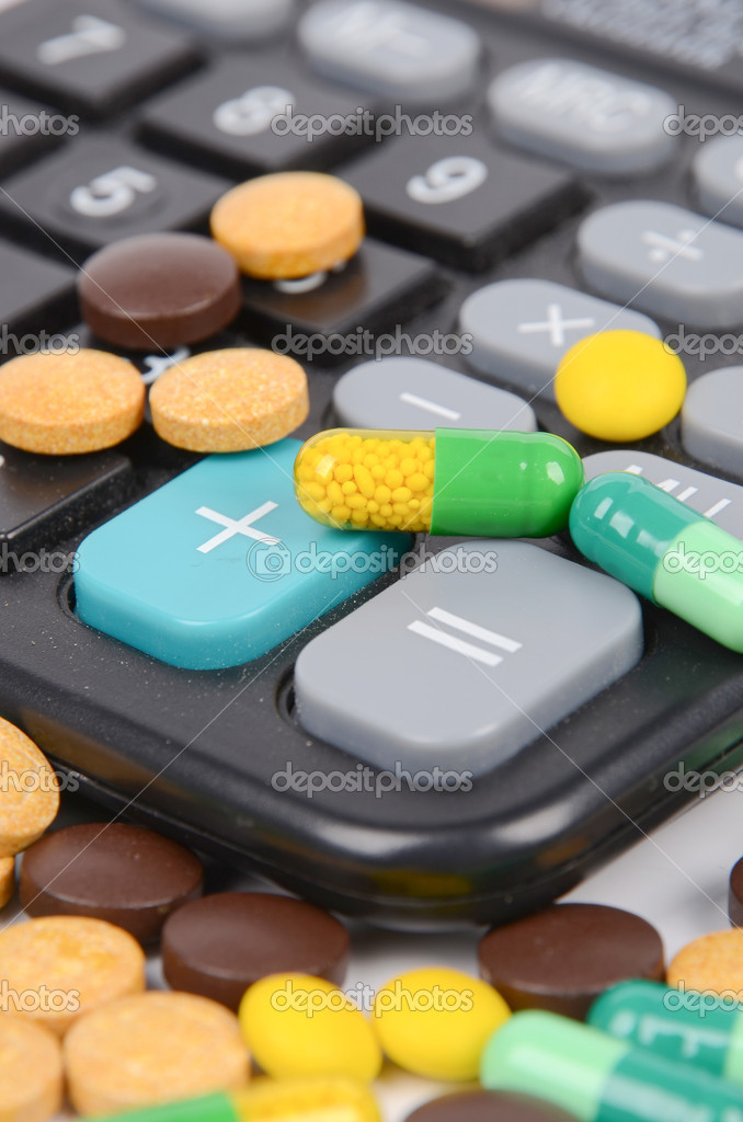Medicine and calculator  Stock Photo #12388794