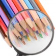 Color pencils and magnifier — Stock Photo