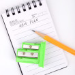 Pencil,sharpener and notepad - Stockfoto