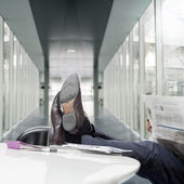 Feet on the desk — Stock Photo