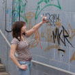 Teen girl and graffiti — Stock Photo