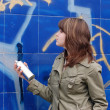Teen girl and graffiti — Stock Photo #11259838