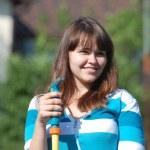 Beautiful young girl watering garden — Foto de Stock   #11330142