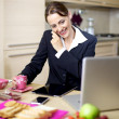 Businesswoman at home during breakfast on the phone - Stock Photo
