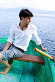 Handsome man on boat in a lake — Stock Photo