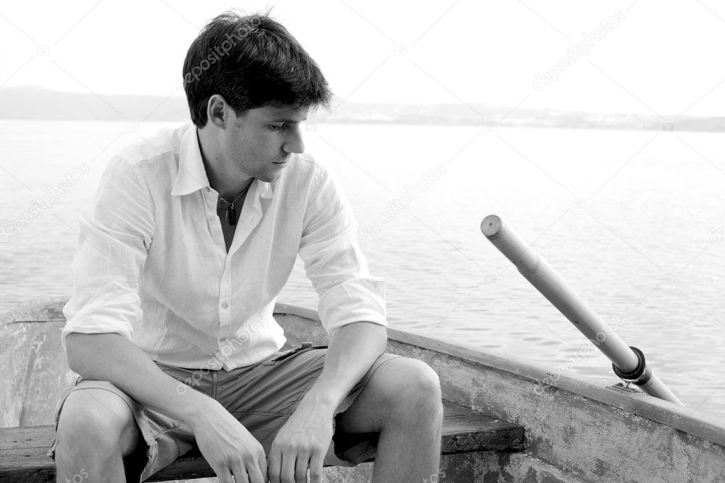 Sad man thinking on a boat — Stock Photo © fabianaponzi ...