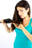 Beautiful woman unhappy about her long hair — Stock Photo