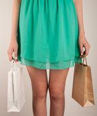 Dziewczyna z torby papierowe — Zdjęcie stockowe
