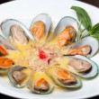 Mussels cooked in white sauce - Stock Photo
