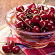 Fresh cherries in bowl — Stock Photo