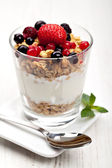 Yogurt with muesli and berries in small glass — Stock Photo
