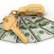 Trinket for the keys to the car and dollars on the white — Stock Photo