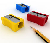 Pencil and pencils sharpeners on white — Stock Photo