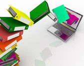 Colorful folders fly into your laptop — Stock Photo