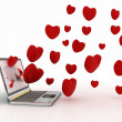 Hearts take off from screen of laptop — Stock Photo #12330398