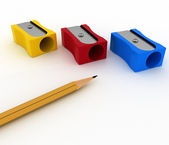 Pencils sharpeners and pencil on white background — Stock Photo