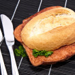 Stock Photo: Meat loaf on roll