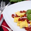 Fresh Raviolis on a plate (with ingredients) — Stock Photo