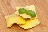 Blank Raviolis on wooden background — Stock Photo