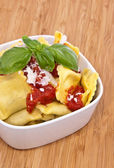 Bowl with Raviolis on wooden background — Stock Photo