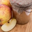 Fresh made applesauce on wooden background — Stock Photo