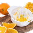 Squeezer with fresh Oranges on white — Stock Photo