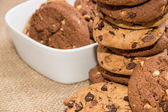 Stacked Cookies with bowl in the background — Stock Photo