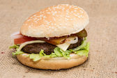 Cheese Burger on rustic background — Stock Photo