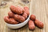 Mini Salamis in a small bowl — Stock Photo