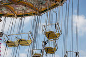 Chairoplane with clouds — Stock Photo