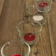Stock Photo: Glasses with Candels on wood