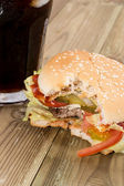 Bitten Off Burger with Softdrink — Stock Photo
