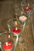 Candles in glasses at daylight — 图库照片
