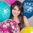 The young woman holding colourful balloons — Stock Photo