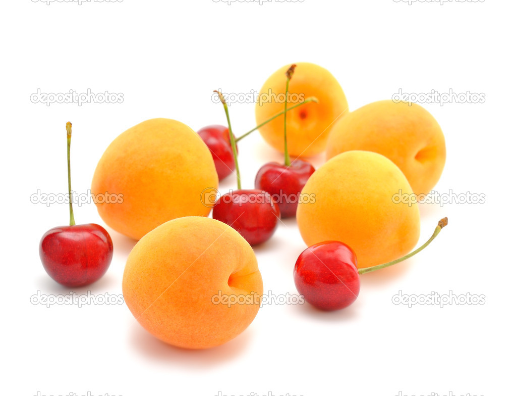 Apricots and cherries on a white background — Stock Photo #11192724