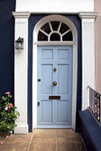 Light blue door — Stock Photo