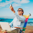 Business man on the beach — Stok fotoğraf