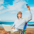 Foto Stock: Business man on the beach