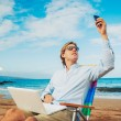 Стоковое фото: Business man on the beach