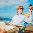 Business man on the beach — Stock fotografie
