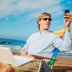 Business man on the beach — Stock Photo