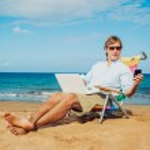 Business man on the beach — Stock Photo #11608127