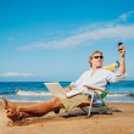 Business man on the beach — Stock Photo #11608132