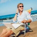 Business man on the beach — Stock Photo #11608135