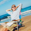 Business man on the beach — Stock Photo #11608137