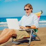 Business man on the beach — Stock Photo #11608141