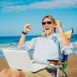 Business man on the beach — Stock Photo #11608142