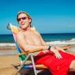 Young Man Relaxing at the Beach - Stock Photo