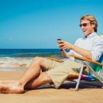 affärsman på stranden — Stockfoto